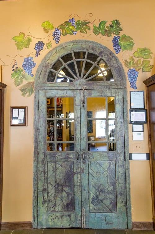 Murals by Virginia Warwick seen at Orion Wine & Spirits, Frederick - Vineyard vines