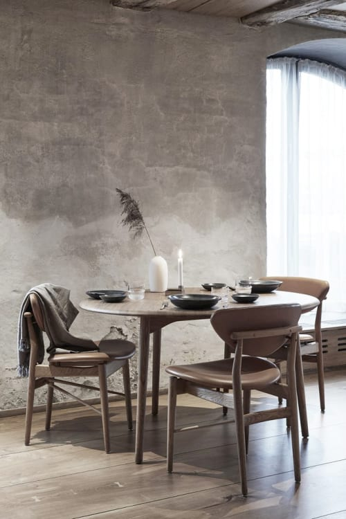 Tables by Jonas Lyndby Jensen seen at Restaurant Barr, København - Riverstone Dining Table
