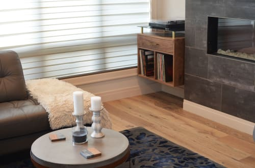 Tables by Freeze Design Build seen at Private Residence, Sioux Falls - Brass and Walnut Record Shelf