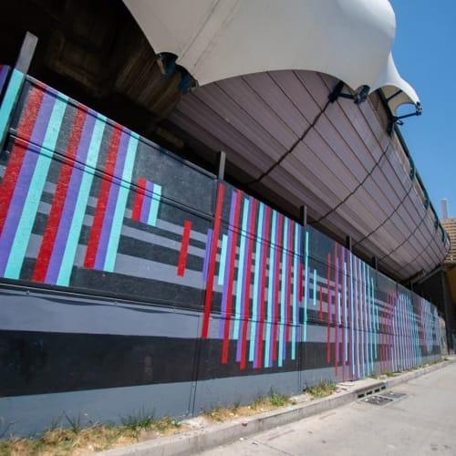 Street Murals by Pixel Art seen at Bío Bío metro station, Santiago - Agitation