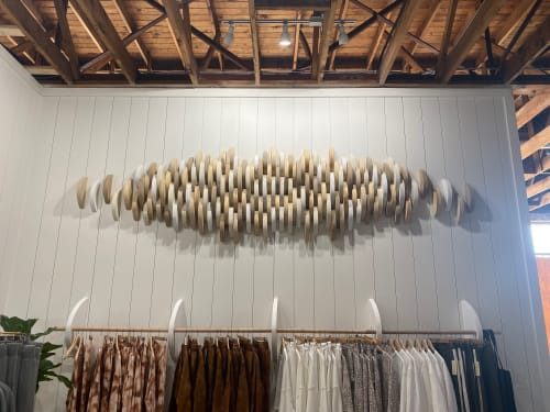 Interior Design by Emily Barton Design seen at Provision, Hartwell - Neutral Toned Wood Slice Art Installation