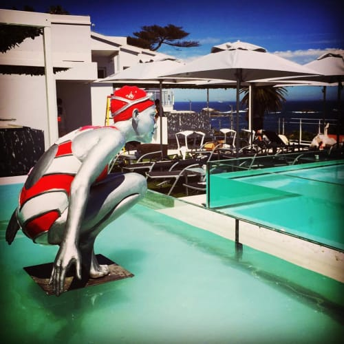 Sculptures by Marieke Prinsloo Rowe seen at South Beach Camps Bay Boutique Hotel, Cape Town - Floating Swimmer