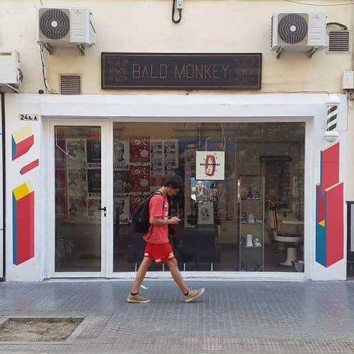 Murals by Mr Drili seen at Bald Monkey Barber Shop, Sevilla - Bald Monkey