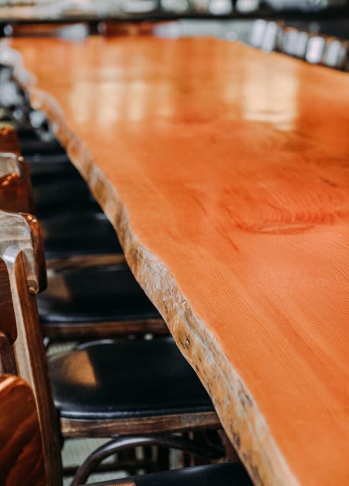 Tables by Nordic Woodcraft seen at The Lark Santa Barbara, Santa Barbara - 16' Long Communal Slab Table