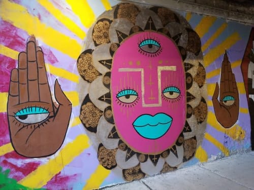 Murals by Natalia Virafuentes seen at 1544 S Wood St, Chicago - Red Face and Hands with Eyes