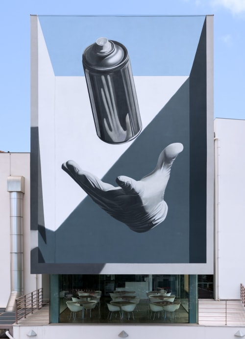 "Street Murals by Nuno Viegas seen at Museum of the Moving Image, Leiria - ""Glove x Can II"""