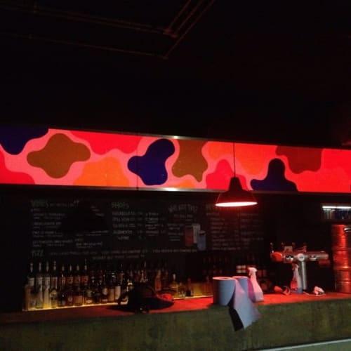Murals by Saskia Pomeroy seen at Queen of Hoxton, London - Multi cow print bar light