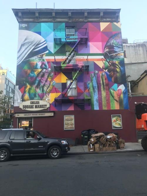 Work by Eduardo Kobra seen at Chelsea Square Market, New York - Gandhi and MotherTeresa Mural