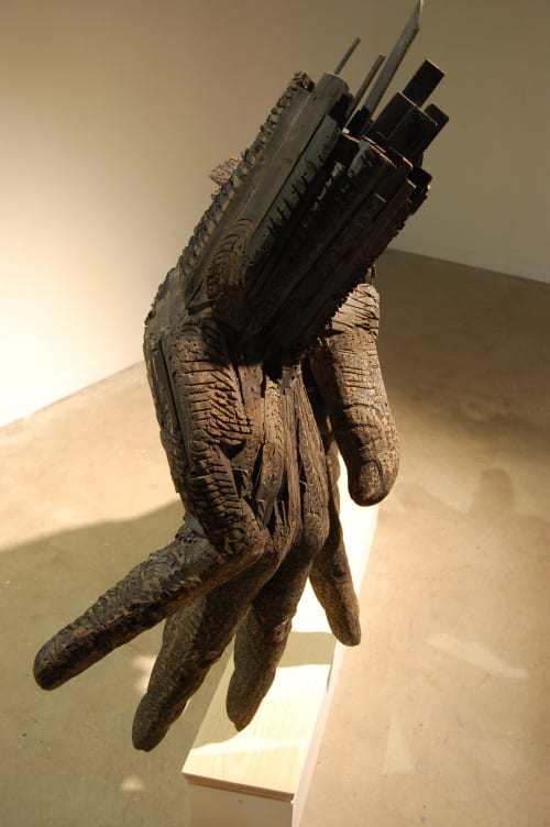 Sculptures by Andrew Ramiro Tirado seen at DoubleTree by Hilton Greeley at Lincoln Park, Greeley - Paired Hands, Black