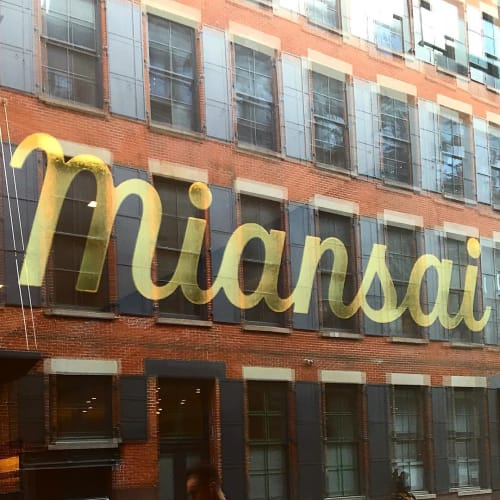 Signage by Kelly Thorn seen at Miansai SoHo, New York - Window Logo