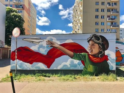 Street Murals by Marek Looney Rybowski seen at Gdańsk, Gdańsk - Mural (boy with paper plane)