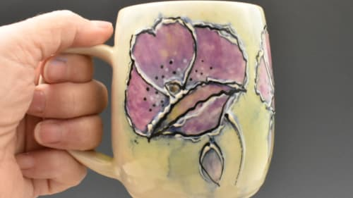 "Cups by Yellow Cottage Pottery seen at Yellow Cottage Studios, Poteau - ""Garden Party"" Mugs"