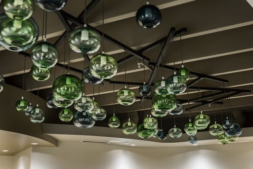 Lighting by Gathered Glassblowing Studio seen at Oasis Center - Jackson College, Jackson - Oasis Canopy