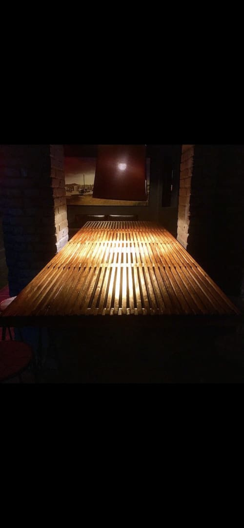 Tables by Duncan Custom Woodwork seen at Odeon, Louisville - Mid Century Inspired Slat Bar Table
