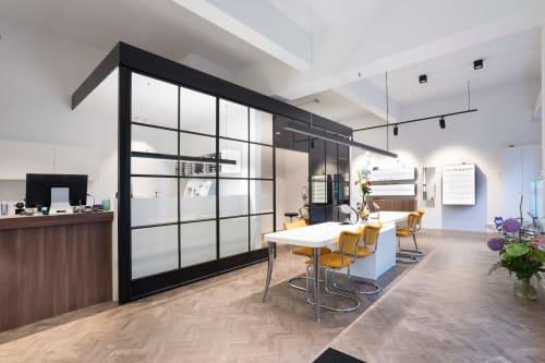 Interior Design by OMNII design seen at Van der Linden & de Vos Optiek, Rotterdam - Van der Linden & de Vos Optiek