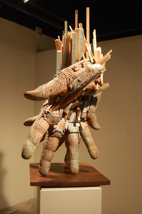 Sculptures by Andrew Ramiro Tirado seen at Coburn Gallery at Colorado College, Colorado Springs - Paired Hands (Colorado Gray)