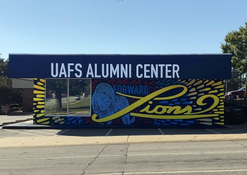 Murals by Bryan Alexis seen at UAFS Alumni Association, Fort Smith - Forward Lions