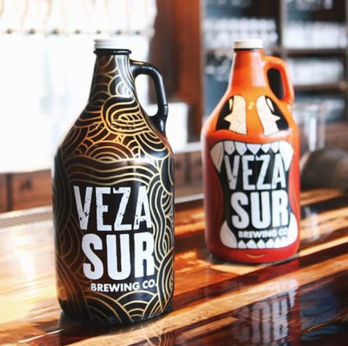 Signage by Jorge-Miguel Rodriguez seen at Veza Sur Brewing Co., Miami - Hand Painted Growlers