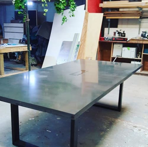Tables by Kia Hanga seen at Private Residence, Liverpool - Black concrete board room table