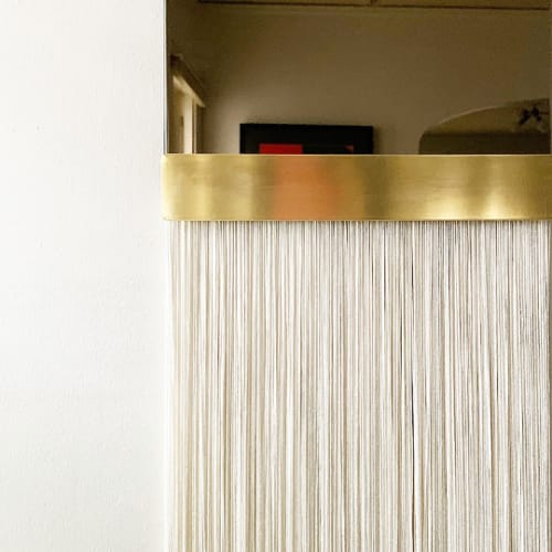 "Wall Hangings by Candice Luter Art & Interiors seen at Creator's Studio, Cedar Rapids - ""Svara"" Arch Mirror Brass Fringe Modern Tinted"