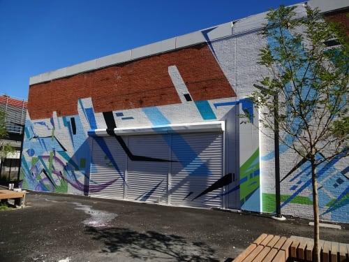 Murals by Jared Goulette   The Color Wizard seen at Elevated Thought, Lawrence - Elevated Thought Foundation exterior Mural