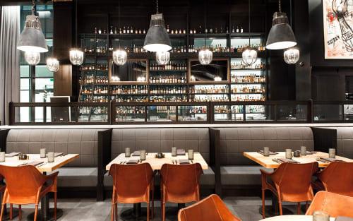 Interior Design by Black Hound Design Company seen at 1801 Wewatta St, Denver - Hearth & Dram restaurant