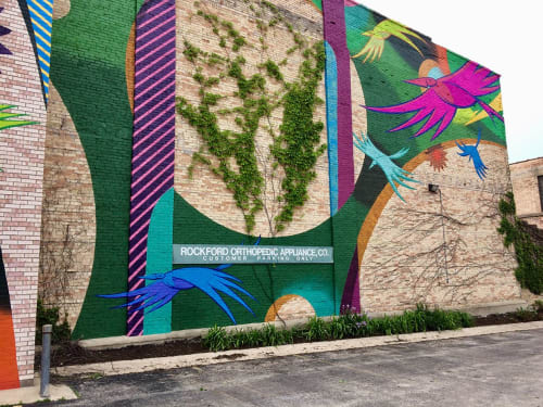 Murals by Chris Silva seen at 422 E State St, Rockford - Round Trips
