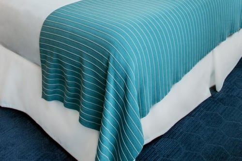 Linens & Bedding by Studio Twist seen at Kinzie Hotel, Chicago - Knitted Throw in Polypropylene - Armadillo stitch