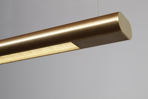 Pendants by Daikon Studio seen at Private Residence, Brussels - Yakata Linear Chandelier in Brushed Brass