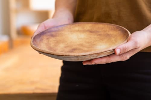 Tableware by MaryMar Keenan seen at Maldon & Mignonette, Sea Cliff - Brown Leather Matte Pasta Bowl