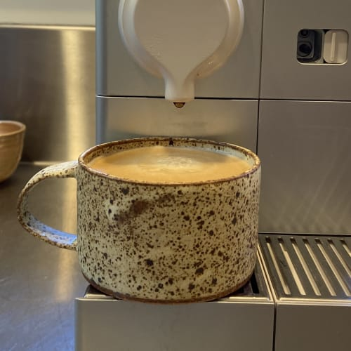 Cups by cursive m ceramics seen at Creator's Studio, Oakland - speckled short modern mug