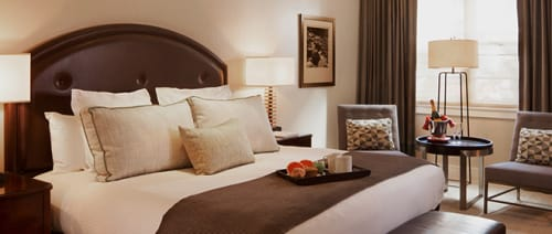 Linens & Bedding by Studio Twist seen at Limelight Hotel - Aspen, Aspen - Knitted Throw in Polypropylene & Polyplush - Links & Lace stitch