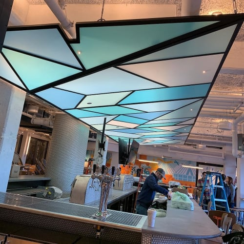 Furniture by American Handcraft seen at Night Shift Brewing - Lovejoy Wharf, Boston - Ceiling Features - faux stained glass
