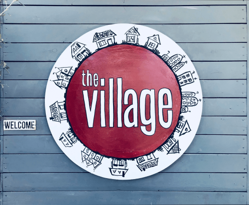 "Signage by ""Kasey Jones, Ink."" seen at The Village, Los Angeles - The Village Logo"