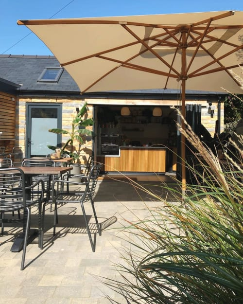 Contour Dining Arm Chair   Chairs by Origin Furniture   Two Islands Ice Cream in Abersoch