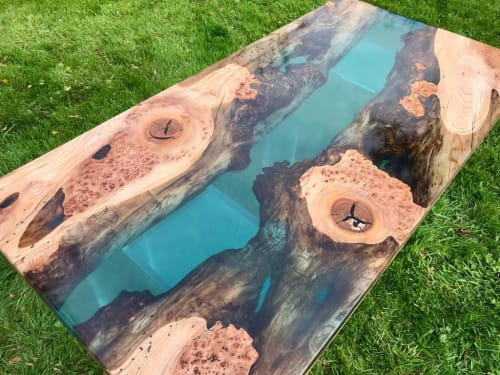Tables by Raven River Designs seen at Private Residence, London - Marine Blue Resin and Elm River Table