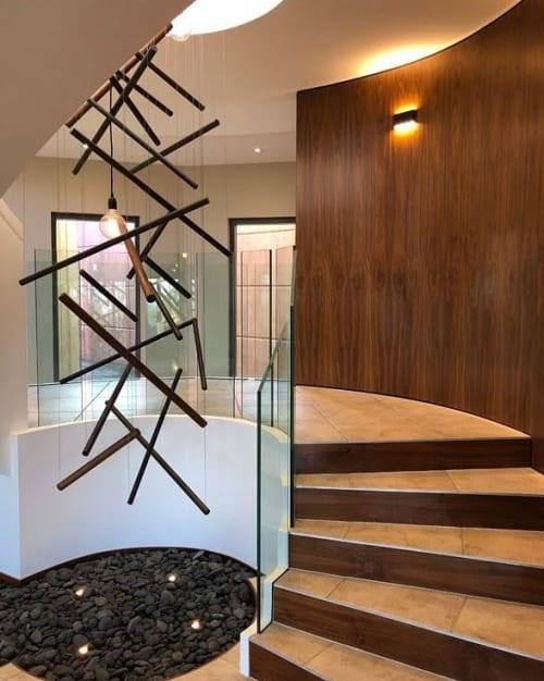 Lighting by ILANEL DESIGN STUDIO seen at Private Residence, Toowoomba - Eight-meter-high handcrafted custom piece STICKS