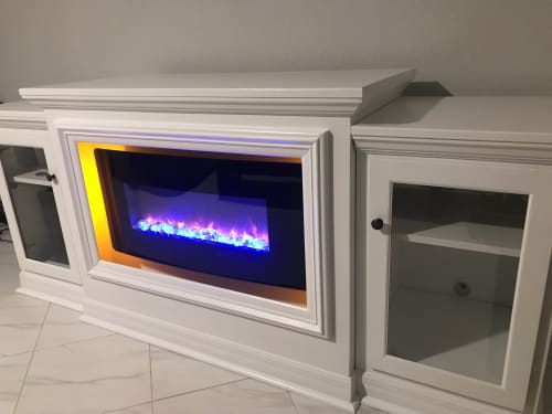 Furniture by Wolfkill Woodwork seen at Private Residence, Palm Beach - Entertainment Center with LED Fireplace