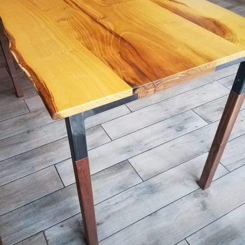 Tables by BEVEL WOOD & METAL seen at The Levee Cafe, Lawrence - Mulberry dining table