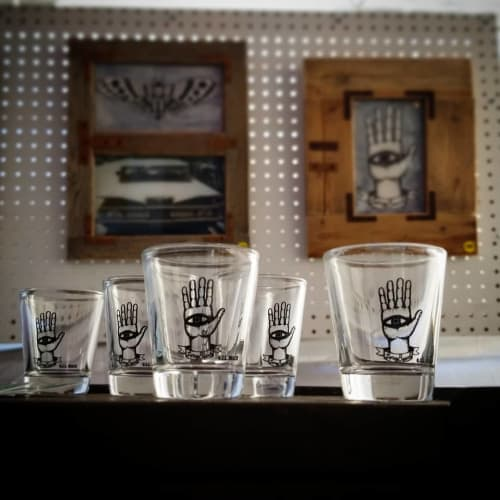"Cups by O.I.L. Beach by Michael Biagiotti seen at Urban Hive Market, Long Beach - Shot Glasses & 2 original works - ""Death Moth"" & ""Hamsa"""