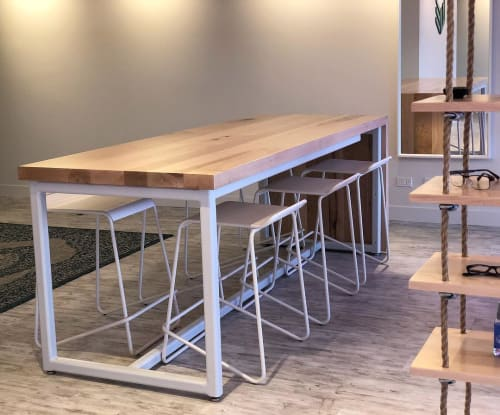 Tables by Chicago Forestry seen at Wanderlust Eyecare, Northfield - Waterfall Table