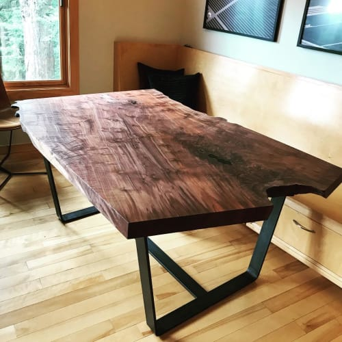 Tables by Jeff Burwell seen at Private Residence, Mill Valley - Walnut Slab Table