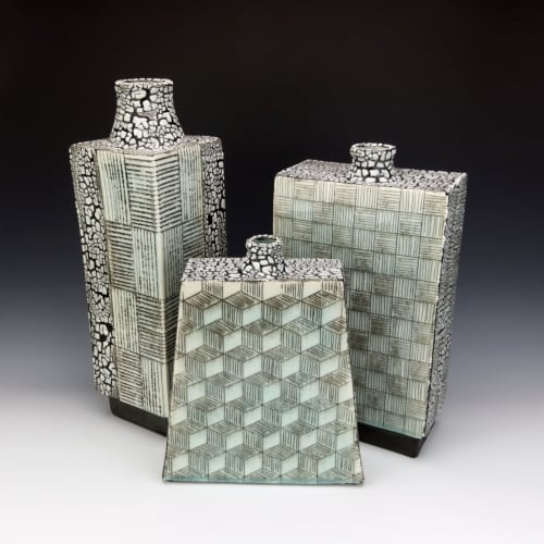 Vases & Vessels by Pierre Bounaud Ceramics seen at Private Residence, Poway - Set of porcelain vessels with geometric inlaid designs