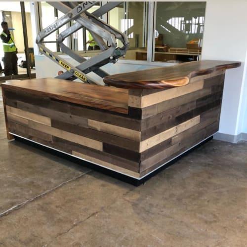 Furniture by Island Reclaimed Wood seen at Harry & Jeanette Weinberg Hoʻokupu Center, Honolulu - Reception Desk