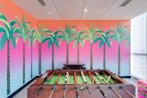 Wallpaper by Neethi seen at WeWork Salarpuria Symbiosis, Bengaluru - Calm Palms