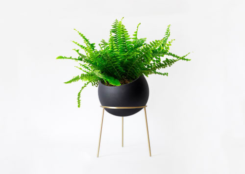 Vases & Vessels by Kitbox Design seen at Private Residence - Globe Floor Planters