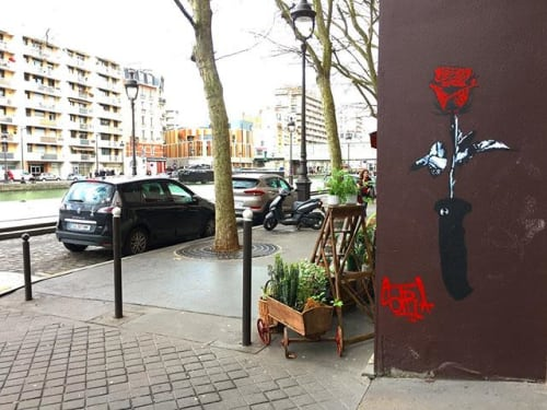 Street Murals by STRA Street seen at Paris, Paris - Loose the knife