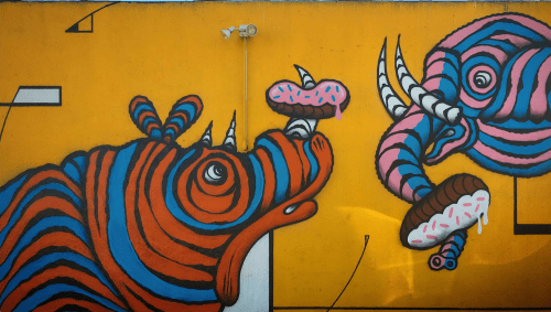 Street Murals by Septerhed seen at Slauson Donuts, Los Angeles - Rhino and Elephant Donut Lovers