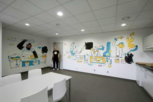 Paintings by A_Poprostu seen at Torun, Torun - hostel kitchen