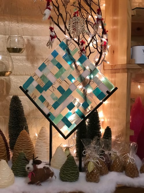 Architecture by KMW Glass Art seen at Magnolia Fine GIfts & Apothecary at Aptos Village, Aptos - Custom glass Fused sculpture in wrought iron stand.